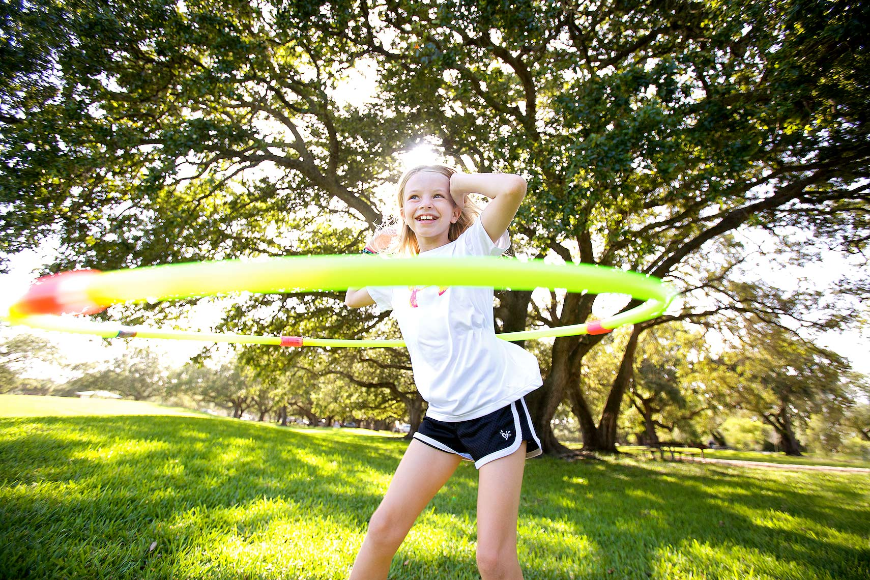 young girl in park with hula hoop_Robert-Holland.jpg