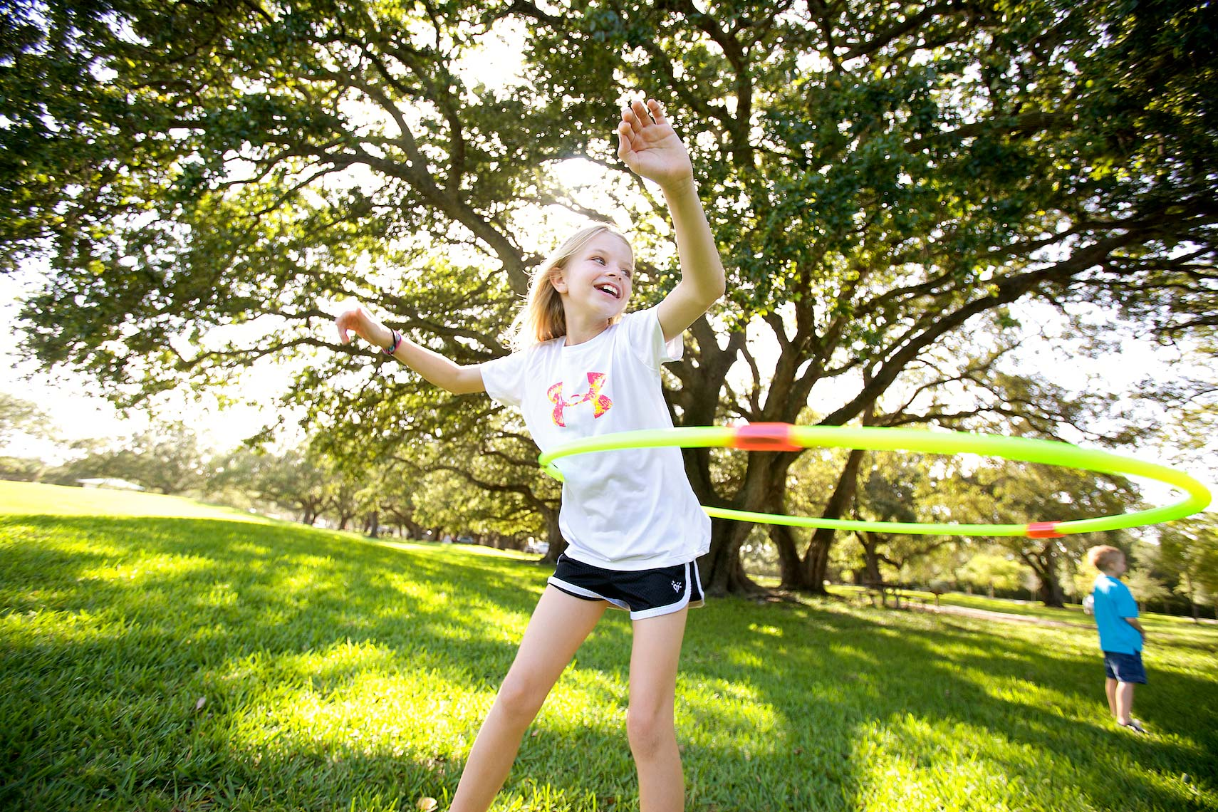 young girl using hula-hoop in park_2166_Robert-Holland.jpg
