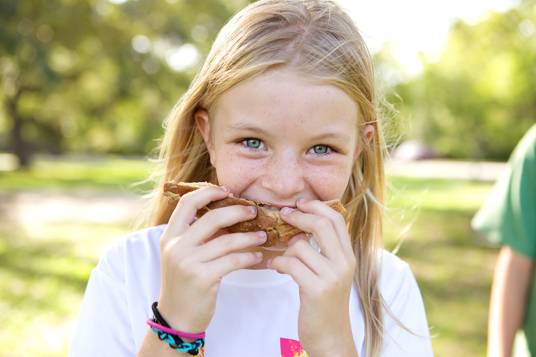 Young girl eating sandwich, close view_2533_Robert-Holland.jpg