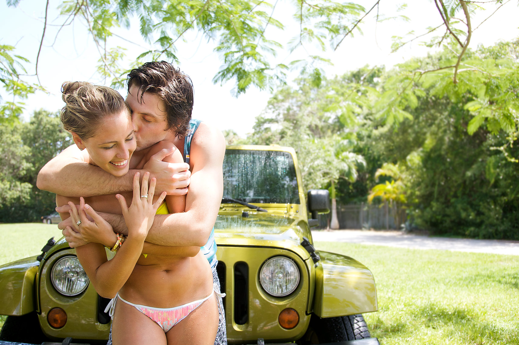 cuple embrace while washng car_Robert-Holland.jpg