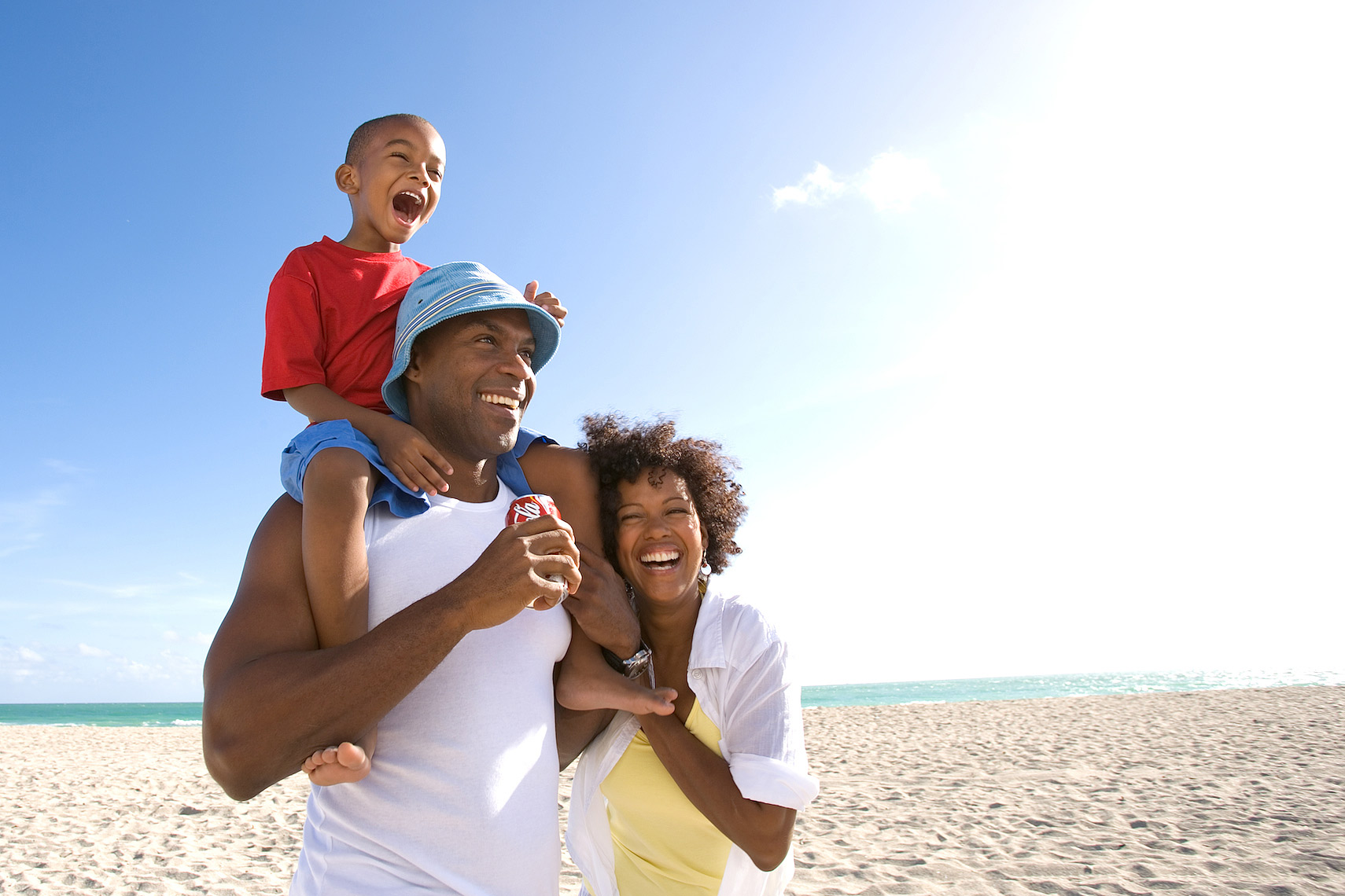 African American family walking on beach with Coca-Cola, Miami_family on beach_Robert_Holland.jpg