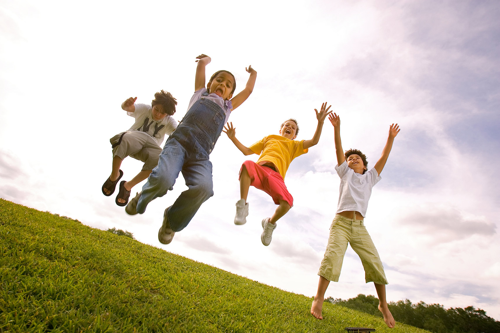 children jumping in air at park_Robert_Holland.jpg ...