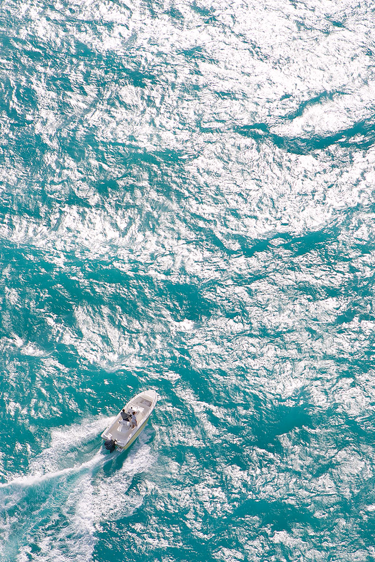 Robert Holland high altitude aerial of small boat in large offshore waves_Y0U5566-(1)