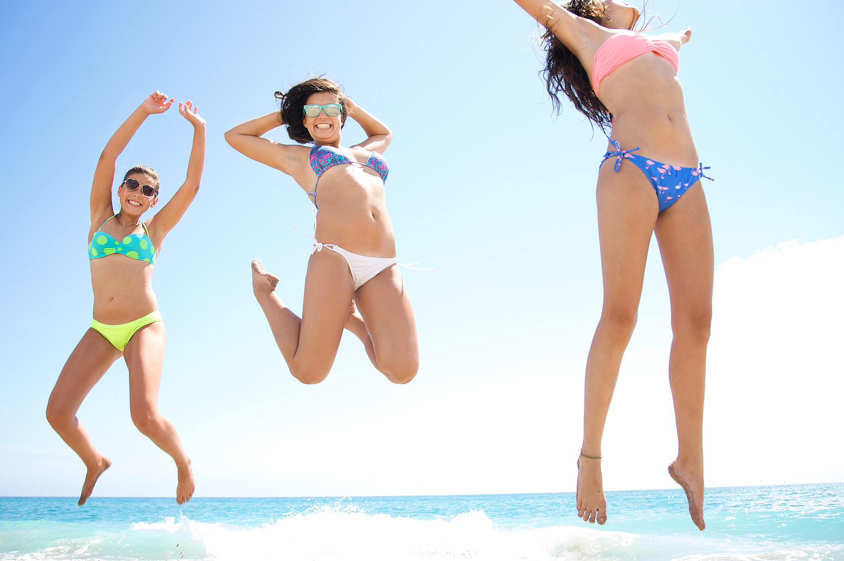 three teenage girls having fun at beach jumping high in air_A2D3329_Robert-Holland.jpg
