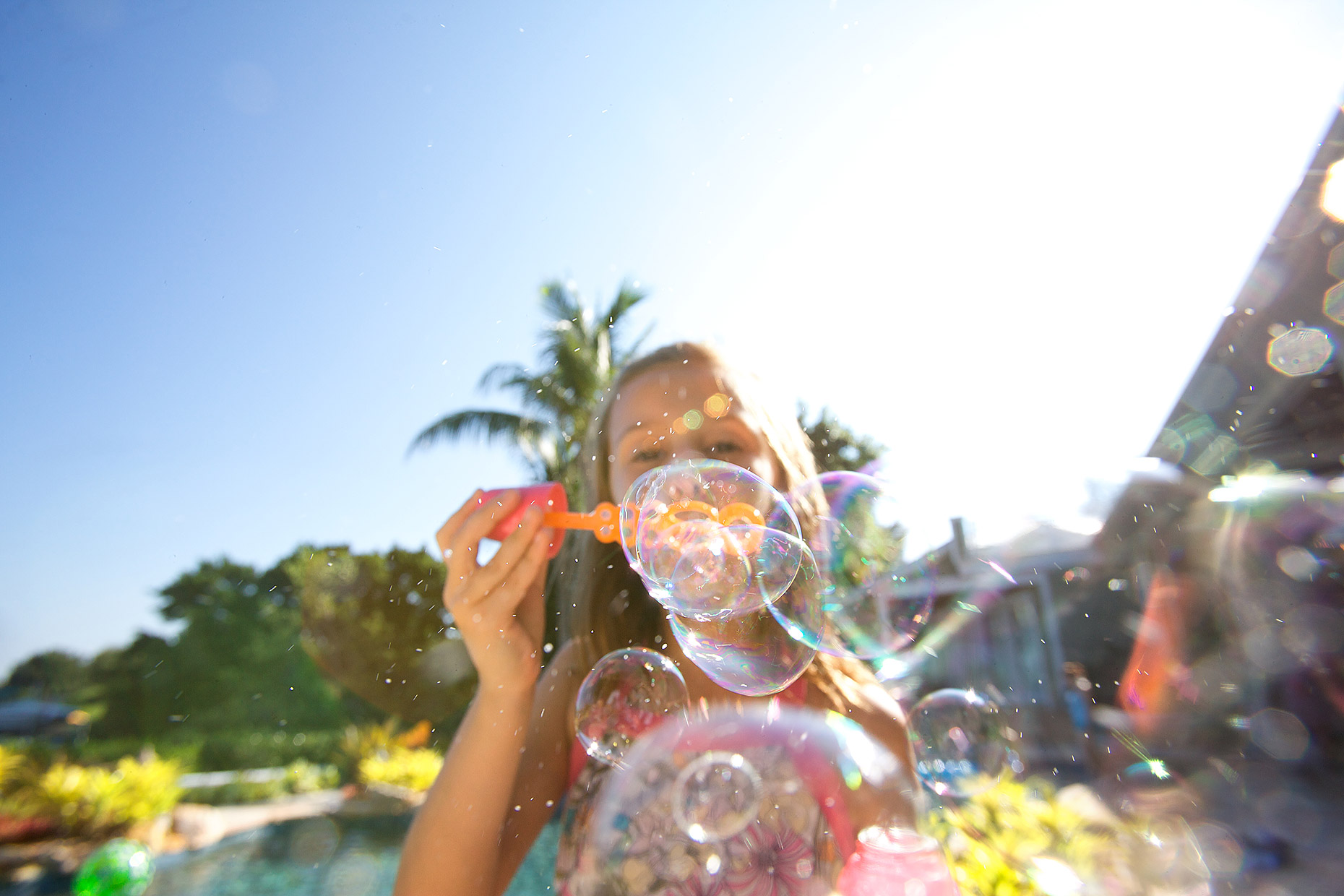 young girl blows soap bubbles pov_Robert_Holland.jpg
