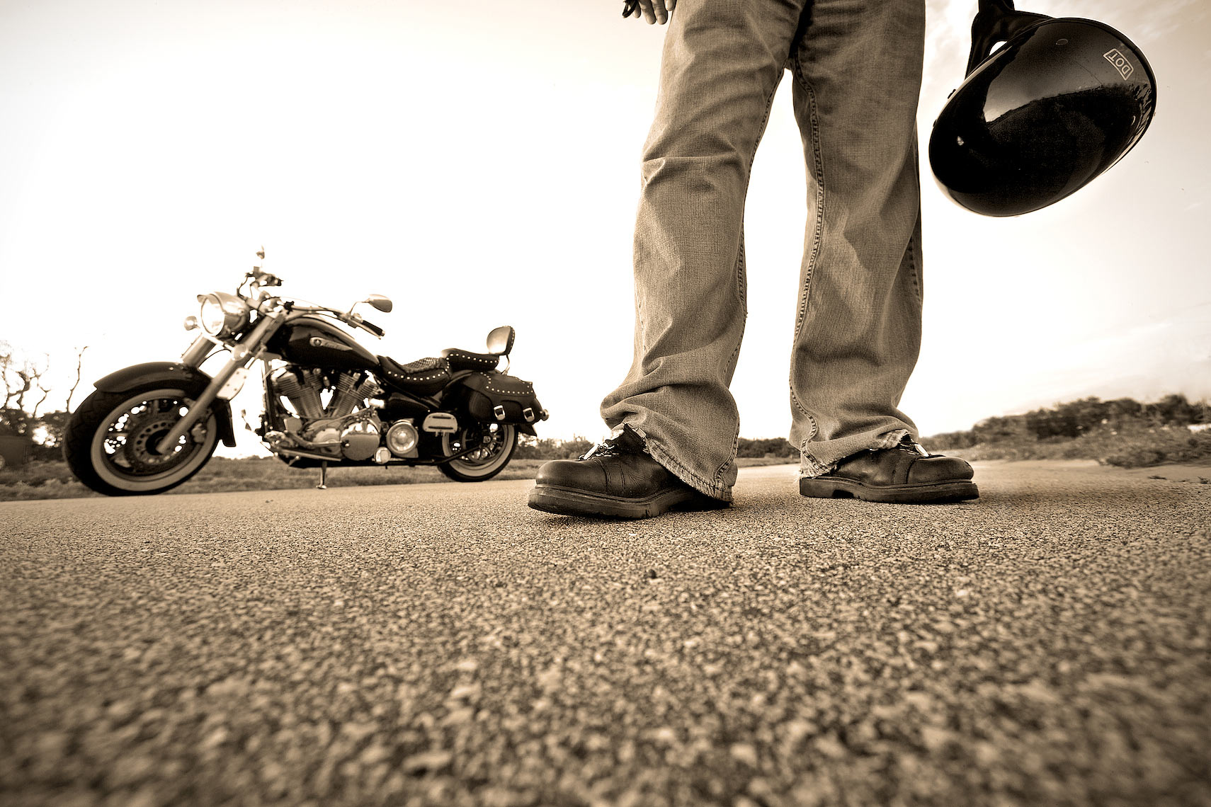low angle view of motorcycle rider standing in road with bike_Robert-Hollan.jpg
