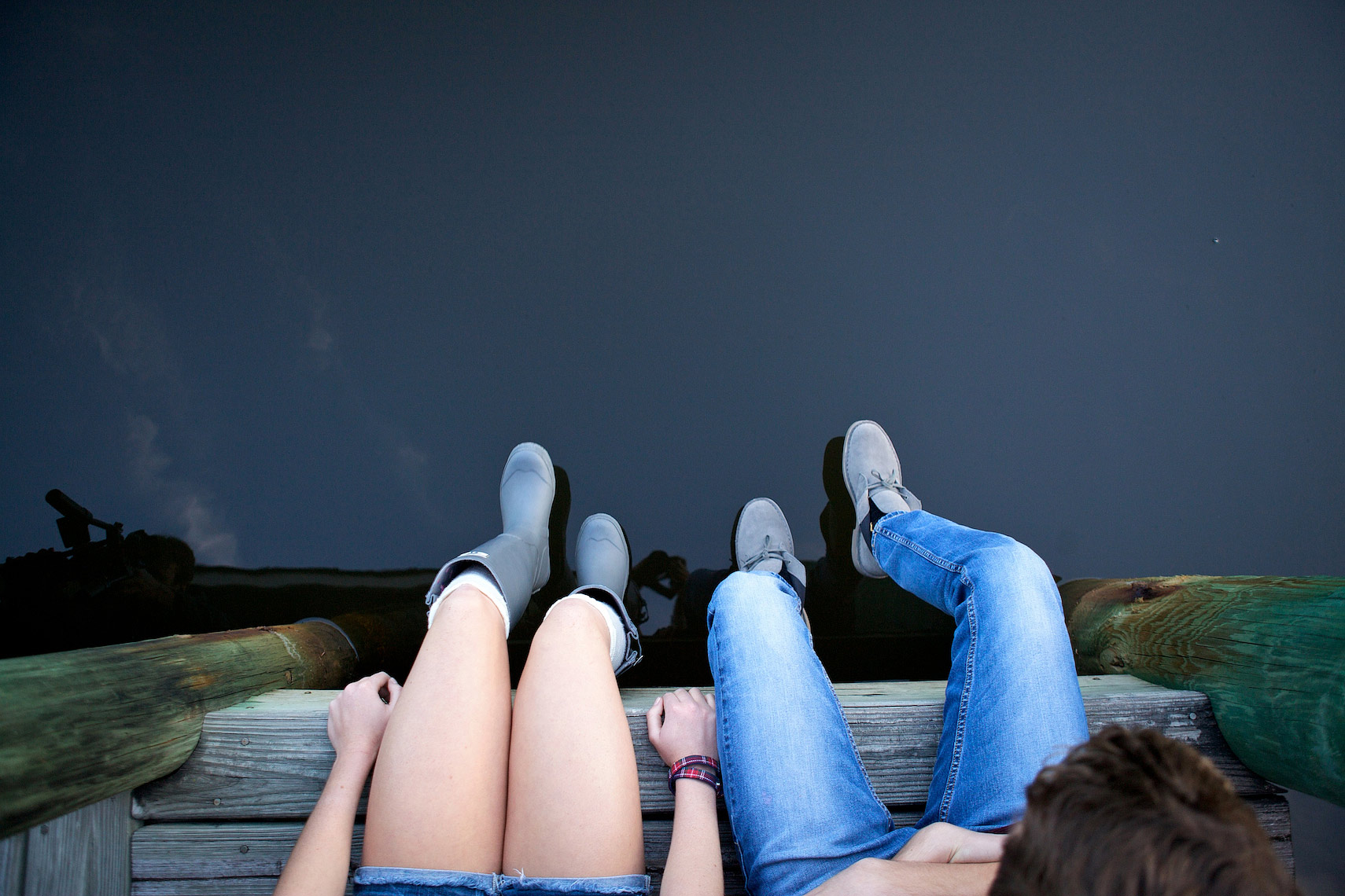 teenagers legs dangle from dock_Robert-Holland.jpg