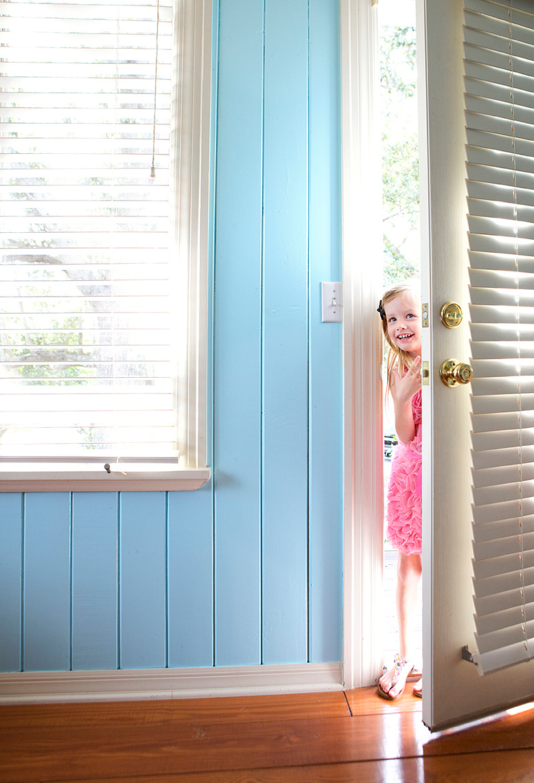 young girl peeks through door from outside_Robert Holland.jpg