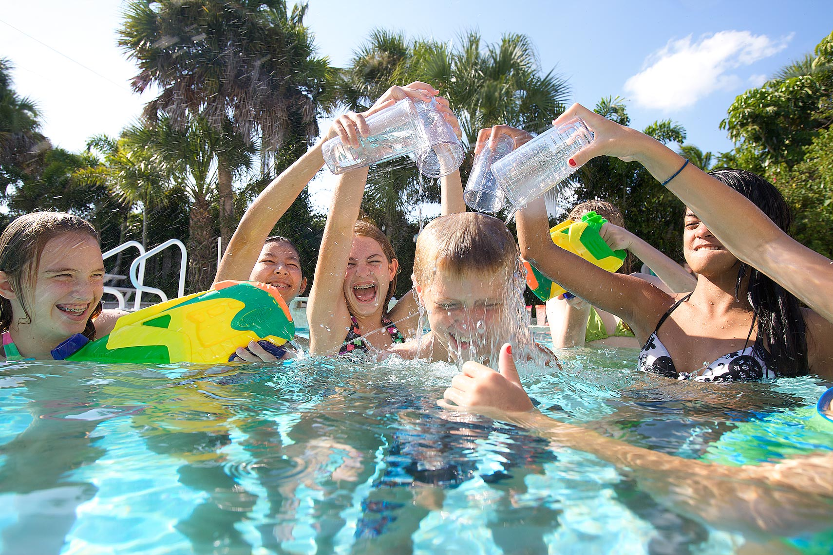 several kids in pool pour water on a boy_MG_3669_Robert-Holland.jpg
