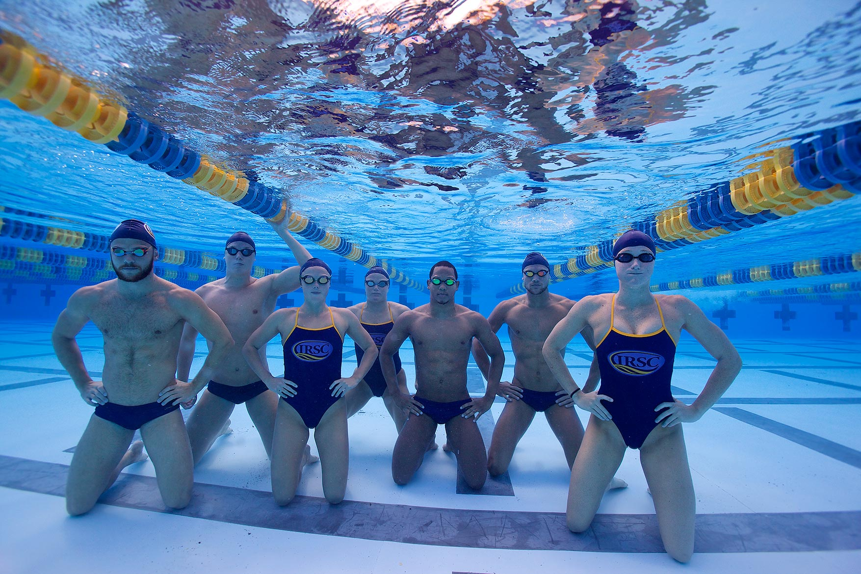 underwater pose of several competitive-college-swimmers__Robert-Holland