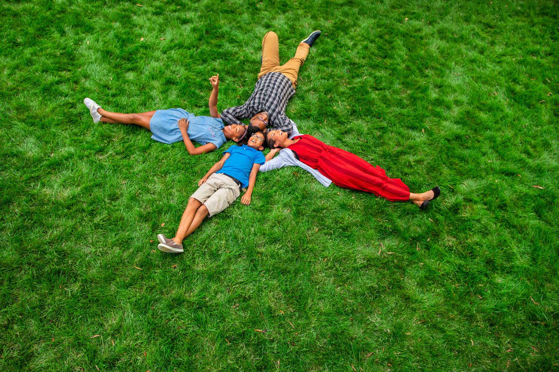 family-laying-on-grass_Robert_Holland